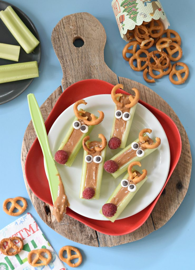 This season we are taking the classic Ants on a Log snack and throwing a holiday twist on it with these Peanut Butter Celery Reindeer Sticks! #christmasfood #funfood #kidfood