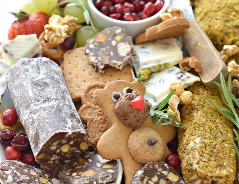 A platter of sweets (chocolate salami, bear cookies, and fruit) for a beautiful Dessert Charcuterie spread