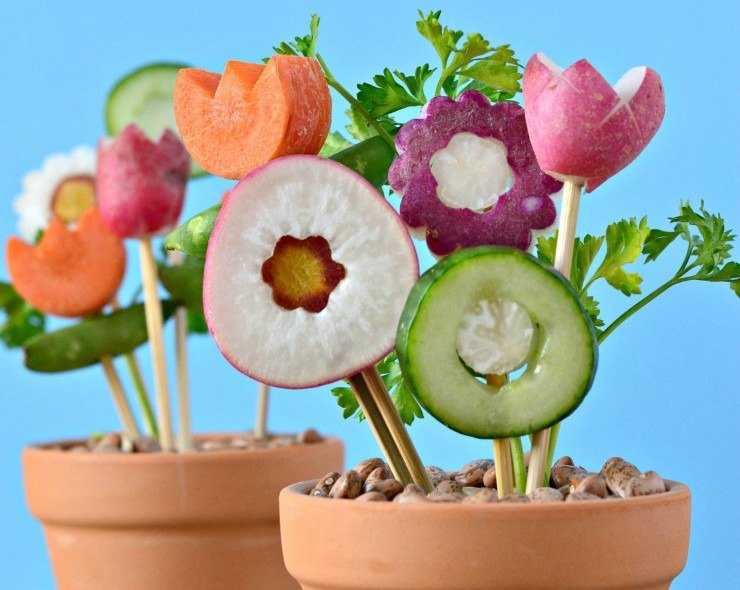 Terra cotta pots stuffed with veggies to look like flowers