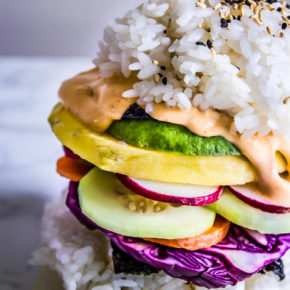 Get your kids involved with piling on the veggies on these Rainbow Sushi Burgers for a perfect meatless meal that all can participate in making & will love! #veganrecipes #kidfood #sushi #dinner