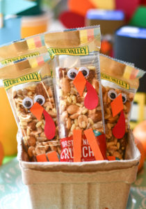 A thanksgiving kid's table with a basket of Turkey Granola Bars